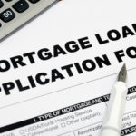 Mortgage loan application form and pen and calculator