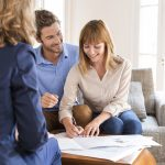 Young,Owners,Couple,Signing,A,Contract,For,House,Investment.