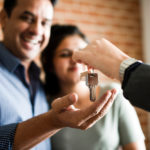 Cheerful,Couple,With,Keys,To,Their,New,Home